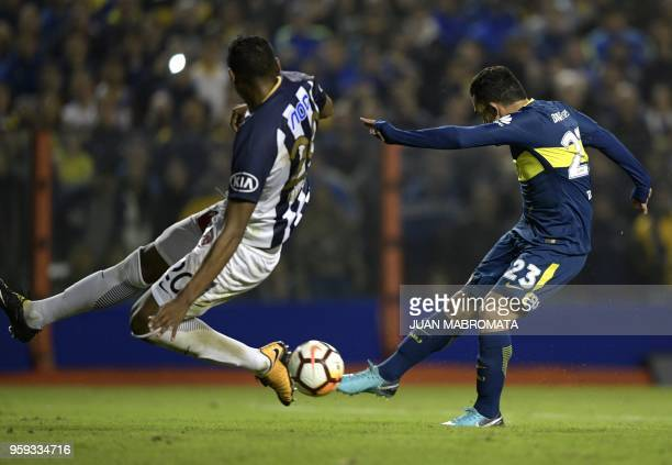 Argentina's Boca Juniors forward Carlos Tevez strikes to score the team's fifth goal against Peru's Alianza Lima during the Copa Libertadores 2018...