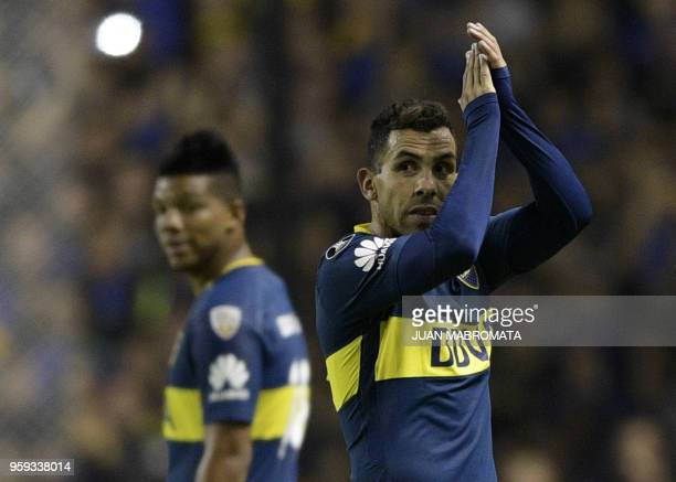 Argentina's Boca Juniors forward Carlos Tevez waves to supporters during their Copa Libertadores 2018 group H football match against Peru's Alianza...