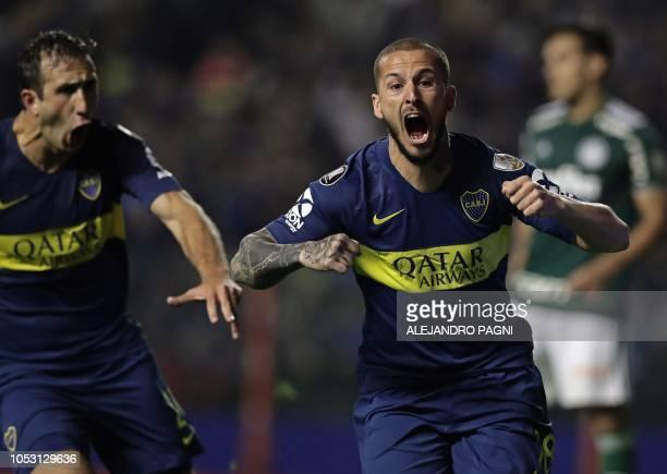Argentina's Boca Juniors forward Dario Benedetto celebrates after scoring a goal against Brazil's Palmeiras during the Copa Libertadores 2018 first...