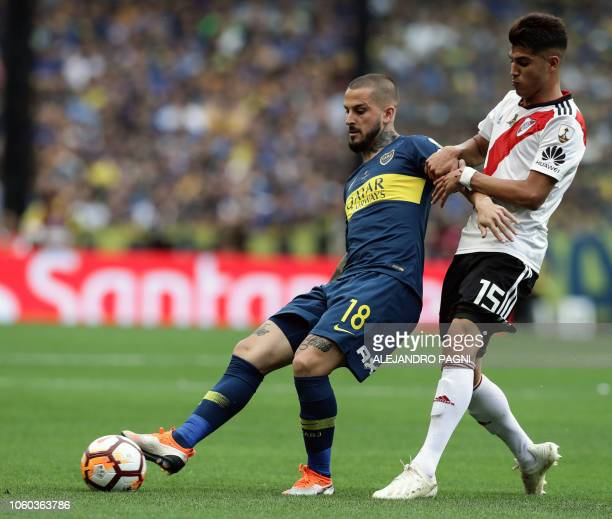 Argentina's Boca Juniors forward Dario Benedetto vies for the ball with River Plate's Exequiel Palacios during their first leg match of the...