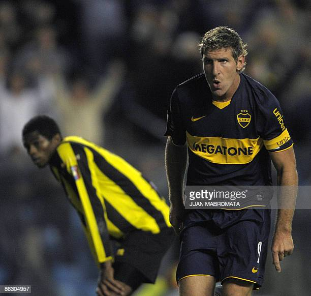 Argentina's Boca Juniors forward Martin Palermo celebrates his second goal next to Venezuela's Deportivo Tachira defender Jose Granados during their...