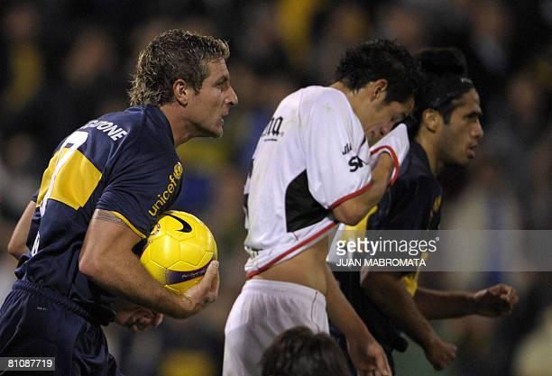 Argentina's Boca Juniors forward Martin Palermo gestures after Mexico's Atlas defender Hugo Ayala scored an own goal during their Libertadores Cup...