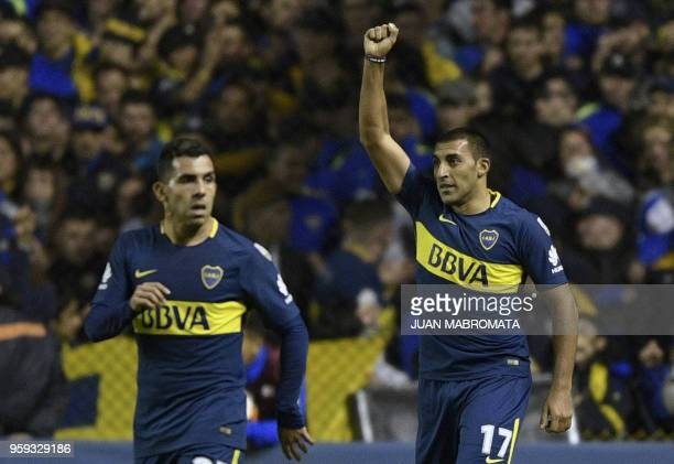 Argentina's Boca Juniors forward Ramon Abila celebrates after scoring the team's third goal against Peru's Alianza Lima during the Copa Libertadores...