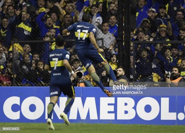 Argentina's Boca Juniors forward Ramon Abila celebrates next to teammate forward Cristian Pavon after scoring the team's third goal against Peru's...