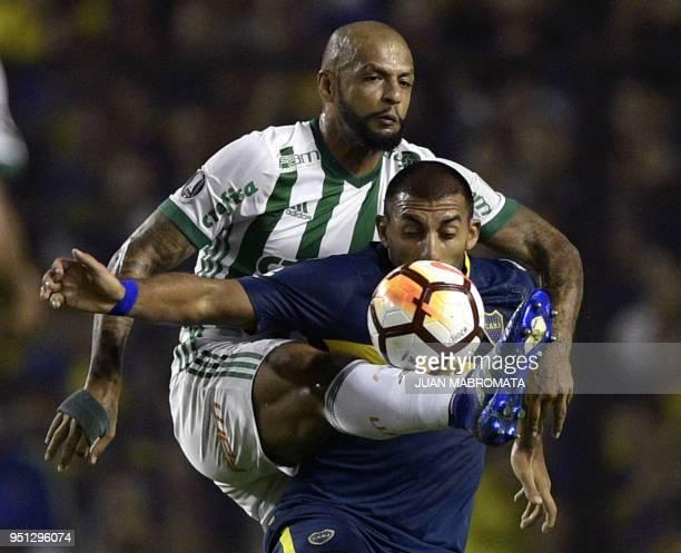 Argentina's Boca Juniors forward Ramon Abila vies for the ball with Brazil's Palmeiras midfielder Felipe Melo during their Copa Libertadores 2018...