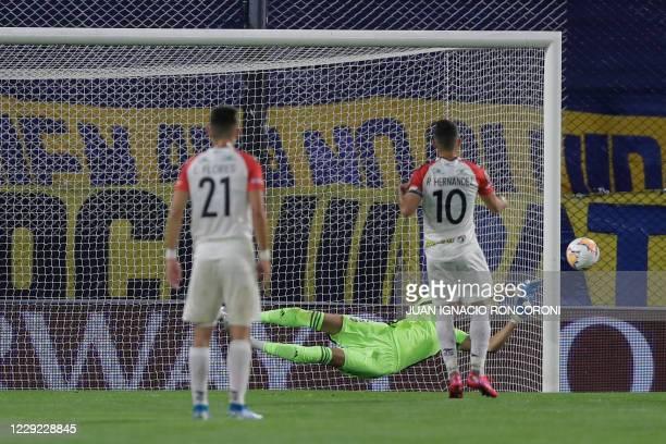 Argentina's Boca Juniors goalkeeper Esteban Andrada dives for the ball during the closeddoor Copa Libertadores group phase football match against...