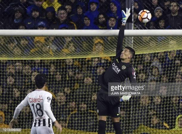 Argentina's Boca Juniors goalkeeper Esteban Andrada jumps to stop the ball during the Copa Libertadores 2018 round of sixteen first leg football...
