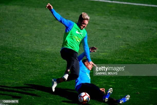 Argentina's Boca Juniors Julio Buffarini vies with Argentina's Boca Juniors Colombian Sebastian Villa during a training session at the Spanish...