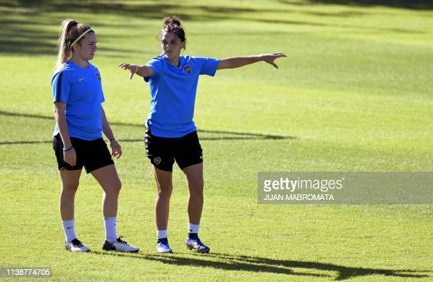 Argentina's Boca Juniors midfielder Camila Gomez and defender Florencia Quinones gesture during a training session in Buenos Aires on March 27 2019...