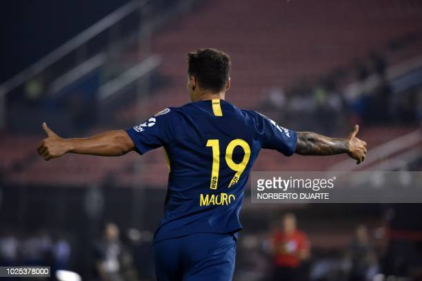 Argentina's Boca Juniors player Mauro Zarate celebrates after scoring a goal against Paraguay's Libertad during their Copa Libertadores 2018 at the...