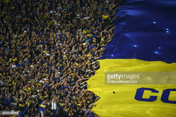 Argentina's Boca Juniors supporters cheer for their team during the Copa Libertadores 2018 group H football match against Colombia's Atletico Junior...