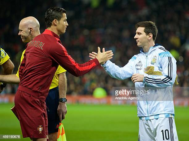 Argentina's captain Lionel Messi shakes hand with Portugal's Cristiano Ronaldo before the international friendly football match between Argentina and...
