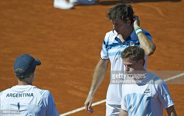 Argentina's Carlos Berlocq and Diego Schwartzman leave the court after losing to Brazil's tennis player Marcelo Melo and Bruno Soares by 75 63 64...