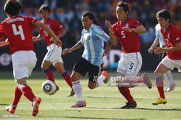 Argentina's Carlos Tevez gets tackled by South Korea's Kim NamIl during the match at National Stadium Johannesburg South Africa Wednesday 17th June...