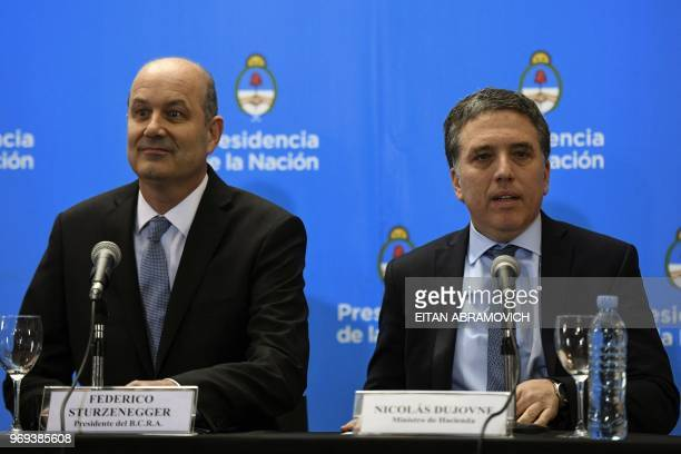 Argentina's Central Bank Governor Federico Sturzenegger and Argentina's Finance Minister Nicolas Dujovne arrive for a press conference in Buenos...