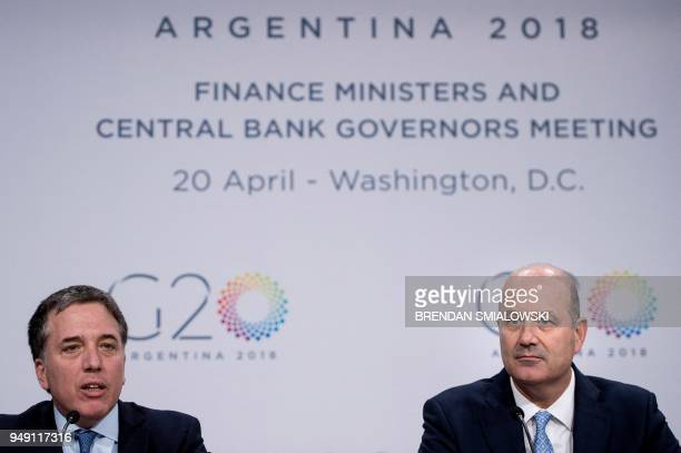 Argentina's Central Bank Governor Federico Sturzenegger listens while Argentina's Finance Minister Nicolas Dujovne speak during a G20 press...