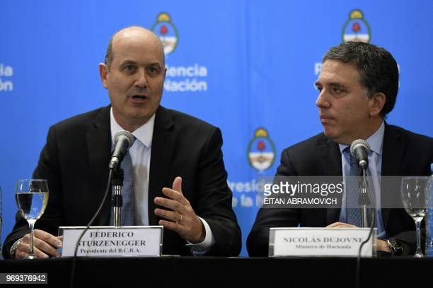 Argentina's Central Bank Governor Federico Sturzenegger speaks next to Argentina's Finance Minister Nicolas Dujovne during a press conference in...