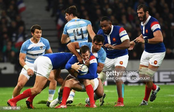 Argentina's centre Matias Orlando tackles France's flyhalf Camille Lopez during the international rugby union test match between France and Argentina...
