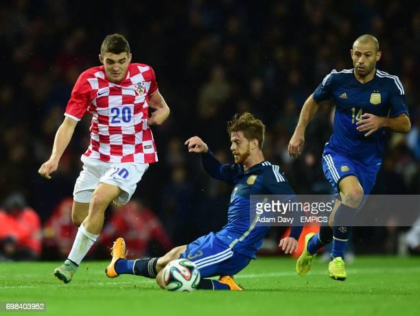 Argentina's Christian Ansaldi and Croatia's Mateo Kovacic battle for the ball