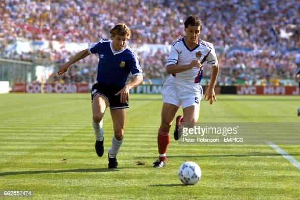 Argentina's Claudio Caniggia and Yugoslavia's Faruk Hadzibegic chase the ball