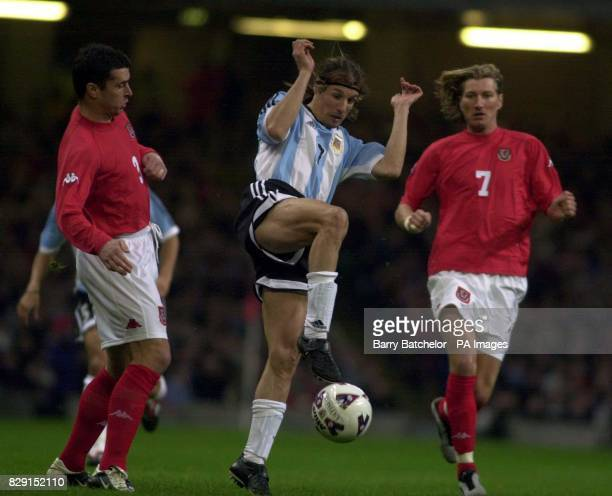Argentina's Claudio Caniggia centre controls the ball past Welsh pair Gary Speed and Robbie Savage during their International friendly match at the...