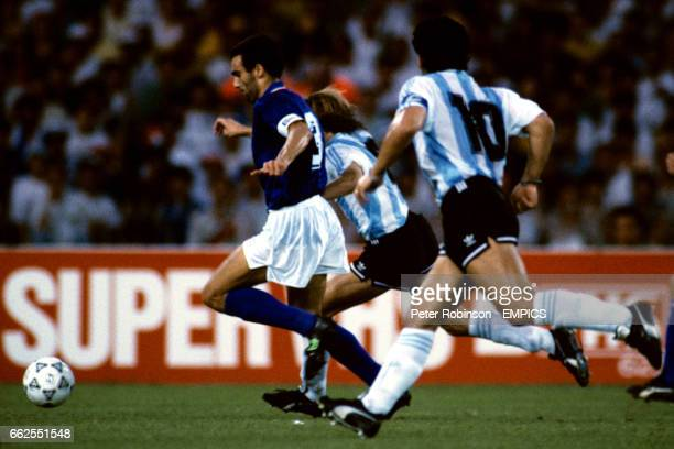 Argentina's Claudio Caniggia chases Italy's Giuseppe Bergomi watched by Diego Maradona