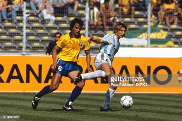 Argentina's Claudio Caniggia lays the ball off under pressure from Brazil's Branco