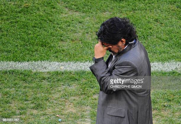 Argentina's coach Diego Maradona gestures during the 2010 World Cup quarterfinal football match against Germany at Green Point stadium in Cape Town...