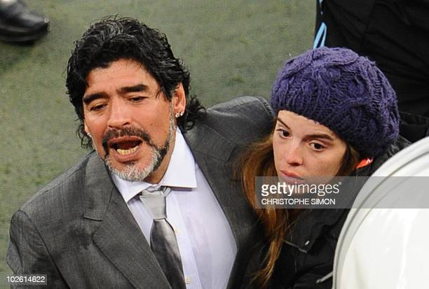 Argentina's coach Diego Maradona is comforted by his daughter Dalma as he leaves the field after losing to Germany in a 2010 World Cup quarterfinal...