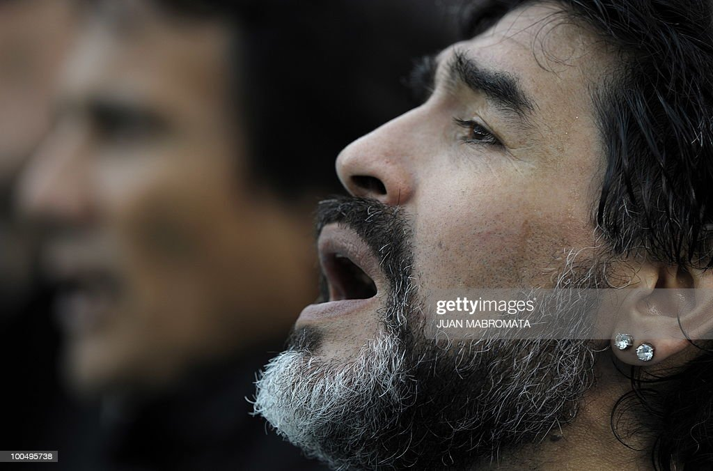 Argentina's coach Diego Maradona sings the national anthem before the start of a friendly football match against Canada at the Monumental stadium in Buenos Aires, on May 24, 2010. Argentina is flying to South Africa for the World Cup finals on Friday, and will play their first match against Nigeria on June 12 in Johannesburg. AFP PHOTO / Juan Mabromata