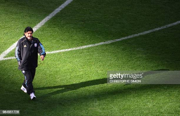 Argentina's coach Diego Maradona walks on the pitch as the teams warm up before the 2010 World Cup quarterfinal football match between Argentina and...