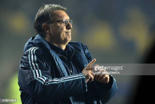 Argentina's coach Gerardo Martino gestures during their Copa America semifinal football match against Paraguay in Concepcion, Chile on June 30, 2015....