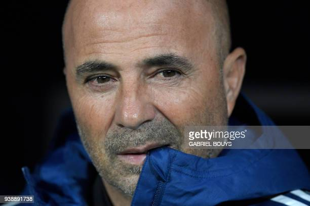 Argentina's coach Jorge Sampaoli bites his jacket during a friendly football match between Spain and Argentina at the Wanda Metropolitano Stadium in...