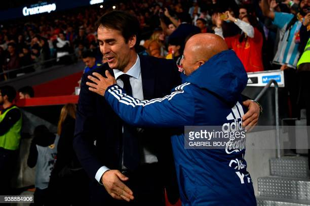 Argentina's coach Jorge Sampaoli greets Spain's coach Julen Lopetegui before a friendly football match between Spain and Argentina at the Wanda...