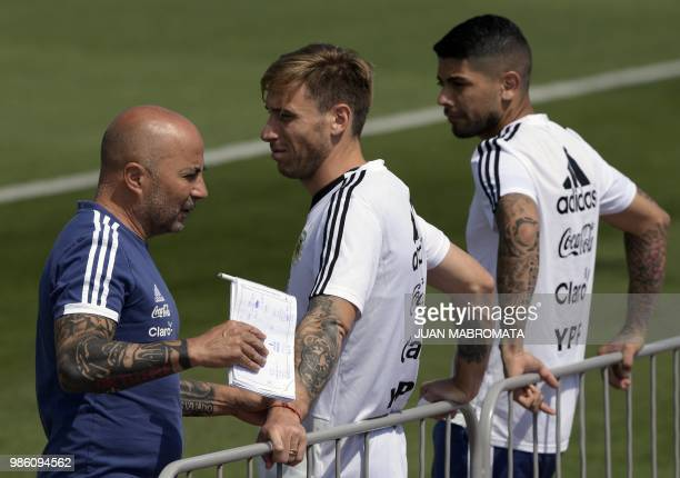Argentina's coach Jorge Sampaoli midfielder Lucas Biglia and midfielder Ever Banega attend a training session at the team's base camp in Bronnitsy...