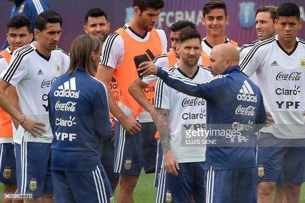 Argentina's coach Jorge Sampaoli speaks to players during a training session of Argentina's national football team at the FC Barcelona 'Joan Gamper'...