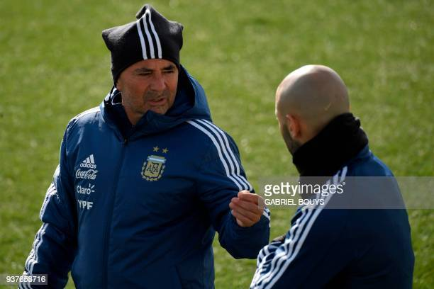 Argentina's coach Jorge Sampaoli speaks with Argentina's defender Javier Mascherano during a training session in Madrid on March 25 2018 ahead of an...