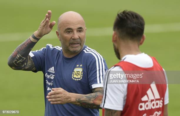 Argentina's coach Jorge Sampaoli talks to a player during a training session at the team's base camp in Bronnitsy on June 13 2018 ahead of the Russia...