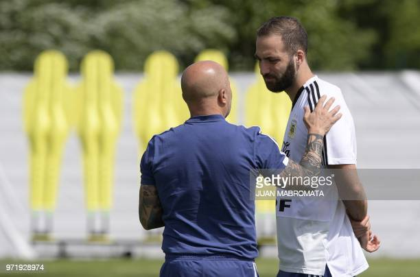 Argentina's coach Jorge Sampaoli talks to Argentina's forward Gonzalo Higuain during a training session at the team's base camp in Bronnitsy near...