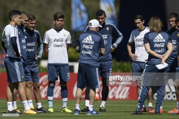 Argentina's coach Jorge Sampaoli talks to footballers during a training session in Ezeiza Buenos Aires on October 6 2017 ahead of a 2018 FIFA World...
