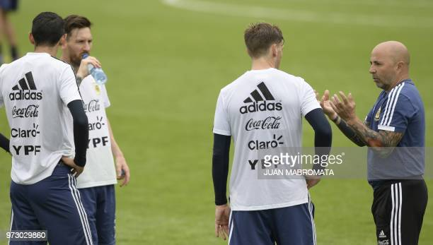 Argentina's coach Jorge Sampaoli talks to midfielder Lucas Biglia during a training session at the team's base camp in Bronnitsy on June 13 2018...
