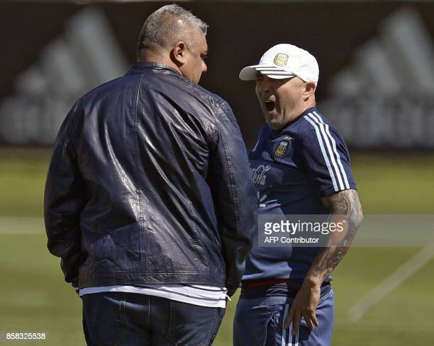 Argentina's coach Jorge Sampaoli yawns next to AFA's President Claudio Tapia during a training session in Ezeiza Buenos Aires on October 6 2017 ahead...