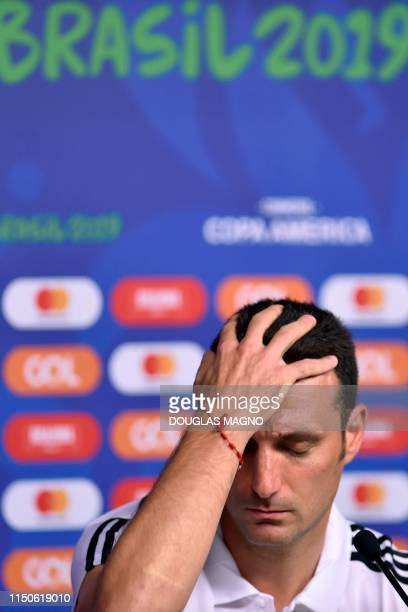 Argentina's coach Lionel Scaloni gestures during a press conference at the Mineirao stadium in Belo Horizonte Brazil on June 18 on the eve of their...