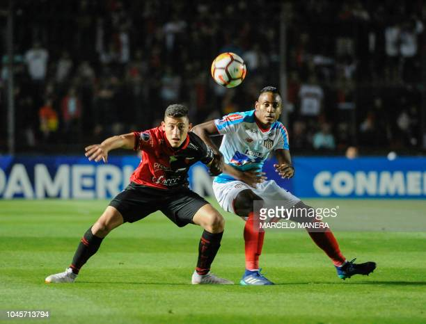 Argentina's Colon Ariel Chaves vies for the ball with Colombia's Junior Fabian Sambueza during their Copa Sudamericana 2018 football match at...