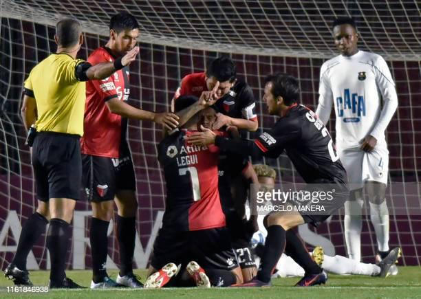 Argentina's Colon de Santa Fe Wilson Morelo celebrates with teammates after scoring against Venezuela's Zulia FC during their Copa Sudamericana...