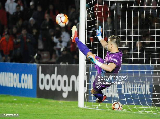 Argentina's Colon goalkeeper Leonardo Burian stops the penalty kick to Brazil's Sao Paulo Bruno Alves during the penalty shootout in the Copa...