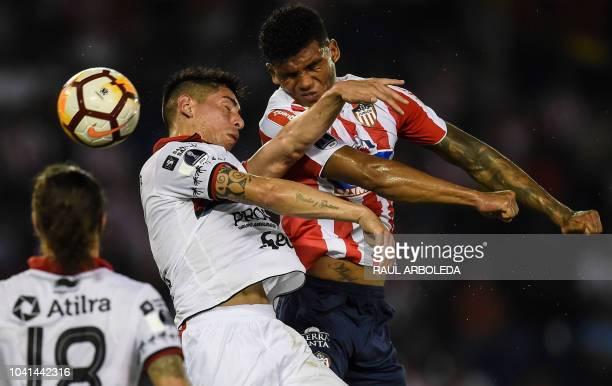 Argentina's Colon player Emanuel Olivera vies for the ball with Colombia's Junior player Rafael Perez during their Copa Sudamericana football match...