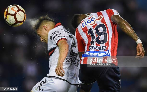 TOPSHOT Argentina's Colon player Gustavo Toledo vies for the ball with Colombia's Junior player Yony Gonzalez during their Copa Sudamericana football...