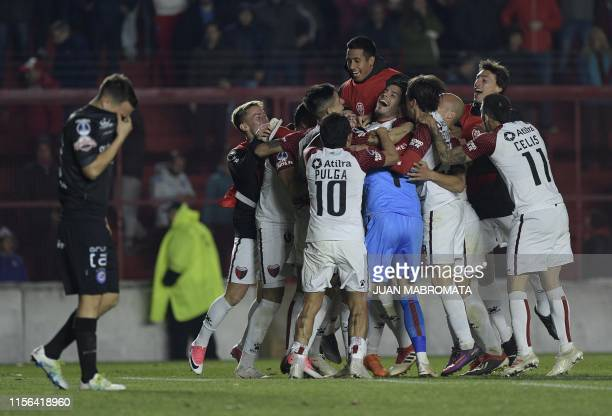 Argentina's Colon players celebrate after defeating Argentina's Argentinos Jrs in a penalty shootout during the Copa Sudamericana sixteen round...