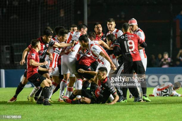 Argentina's Colon Santa Fe players clashes with Uruguay's River Plate players during their Copa Sudamericana football match at the Brigadier Lopez...